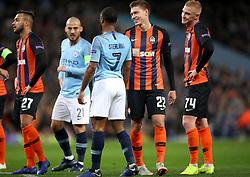 Manchester City's Raheem Sterling (centre) and Shakhtar Donetsk's Mykola Matviyenko (second right) during the match at the Etihad Stadium