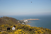 A couple enjoy the views from Killiney Hill Park on 08th April 2017 in County Dublin, Republic of Ireland. Killiney Hill is the southernmost of two hills which form the southern boundary of Dublin Bay. Dublin is the largest city and capital of the Republic of Ireland.