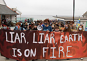 A group of protesters march off Gyllyngvase beach and into Falmouth, Cornwall, as part of the Youth Strike for Climate, ahead of the G7 summit happening at the weekend. 11th June 2021. Anna Hatfield/Pathos