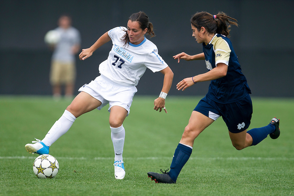 September 02, 2012:  North Carolina forward Marina Nesic (77) controls the ball as Notre Dame's Stephanie Campo (4) defends during NCAA Soccer match between the Notre Dame Fighting Irish and the North Carolina Tar Heels at Alumni Stadium in South Bend, Indiana.  North Carolina defeated Notre Dame 1-0.