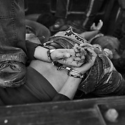 Mexican Federal Police officers stand on top of hand cuffed drug cartel assassins after arresting them in a gun battle in which the assassins had gone on a killing spree in Ciudad Juarez, Mexico. Mexican police are well known for corruption, human rights abuses and in many cases working in partnership with cartels. in 2008 only 38% of Mexican police had their high school diploma. The U.S. aid program to fight drug cartels known as the Merida Initiative supplies mostly weapons and equipment to Mexican security forces.<br /> (Credit Image: © Louie Palu/ZUMA Press)
