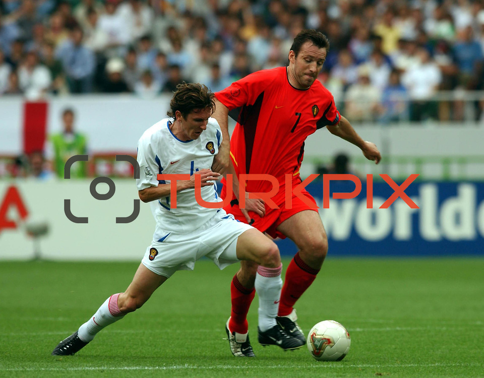 l-r; Alexei Smertin Tangles with Belgium's Marc Wilmots