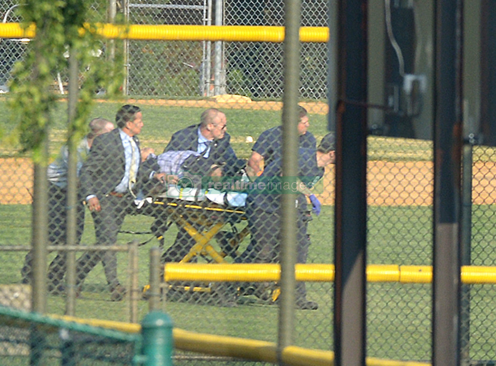June 14, 2017 - Alexandria, Virginia, U.S. - A wounded unknown victim is helicoptered out from a baseball field adjacent to YMCA in Del Ray area. After multiple shots were heard shortly after 7:00AM law enforcement and emergency medical personnel at the 400 block of E Monroe Ave in the DelRay neighborhood of northern Alexandria in the nation's capital. (Credit Image: © Essdras M Suarez/ZUMA Press) *EXCLUSIVE - Must Call for Price before Any USAGE: Licensing@ZUMAPRESS.com or +1.949.481.3747*