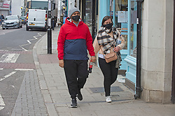 © Licensed to London News Pictures 28/04/2021. Whitstable, UK. People in Whitstable High Street in Kent wearing masks to protective themselves against the threat of Coronavirus. Photo credit:Grant Falvey/LNP