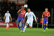 Vincent Kompany of Manchester city beats Gylfi Sigurdsson of Swansea city to the ball.    EFL Cup. 3rd round match, Swansea city v Manchester city at the Liberty Stadium in Swansea, South Wales on Wednesday 21st September 2016.<br /> pic by  Andrew Orchard, Andrew Orchard sports photography.