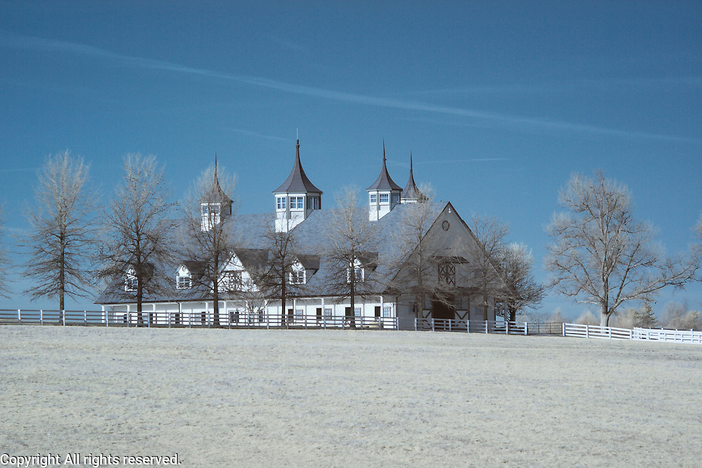 Infrared (IR) image - Manchester Farm.  Another example of the blue/red channel swap processing and of an example of a fancy thoroughbred barn.  This farm is located behind the Keeneland property in Lexington, Kentucky.