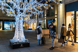Edinburgh, Scotland, UK. 24 December 2020. Last minute Christmas shopping just before the shops close on Christmas Eve at upmarket Multrees Walk in Edinburgh.  Iain Masterton/Alamy Live News.