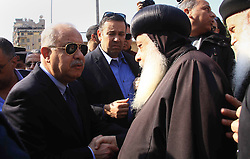 December 10, 2016 - Cairo, Cairo, Egypt - Egyptian Prime Minister Sherif Ismail checks the damaged Saint Peter and Saint Paul Coptic Orthodox Church after a bombing on December 11, 2016, in Cairo's Abbasiya neighbourhood. The blast killed at least 25 worshippers during Sunday mass inside the Cairo church near the seat of the Coptic pope who heads Egypt's Christian minority, state media said  (Credit Image: © Amr Sayed/APA Images via ZUMA Wire)