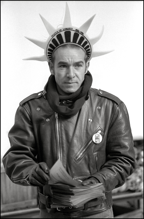 On World's AIDS Day, December 1, 1989, G'dali Braverman of ACT UP picketed at the Immigration and Naturalization Services building in lower Manhattan. The group was protesting the prohibition of all infected persons from obtaining U.S. tourist visas or permanent residence status unless they obtained a special waiver.