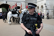 Following recent terror attacks, security is heightened with more armed police on the streets, policing important buildings, as here at Horse Guards Parade during the Changing of the Guard in London, England, United Kingdom.