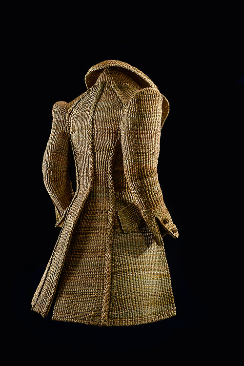 """Hand-made C19th dress-coat and top hat. Woven in fresh-water Bulrush, by Rachel Frost, who is based in the Scottish Borders. <br /> <br /> Rachel Frost graduated from Edinburgh College of art with an honours degree in Model Animation. After initially working for Jim Hensons Creature shop, she set up her own business """"The Crafty Beggars"""" , providing bespoke hand crafted items in a variety of traditional craft disciplines for the Heritage industry. She is a leading authority on the subject of historical felt-hat making techiques with her hand-felted hats held in collections world wide. <br /> www.thecraftybeggars.org"""
