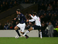 Photo: Andrew Unwin.<br />Scotland v USA. International Challenge. 12/11/2005.<br />Scotland's James McFadden (L) tries to get away from his marker, the USA's Benjamin Olsen (R).