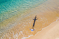 Aerial view of father & daughter playing on Shelly Beach, Caloundra, Sunshine Coast, Queensland, Australia