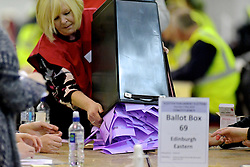 SCOTTISH PARLIAMENTARY ELECTION 2016 – Counting Agents emptying ballot boxes during the vote counting at  the Royal Highland Centre, Edinburgh<br />