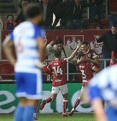 Bristol City's Jamie Paterson (right) celebrates scoring his side's first goal of the game