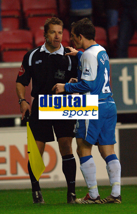 Photo: Paul Greenwood.<br />Wigan Athletic v Sheffield United. The Barclays Premiership. 16/12/2006. Wigan's Leighton Baines chats with the Referee's assistant before the referee changed his mind about a Sheffield United penalty after consulting with his assistant.