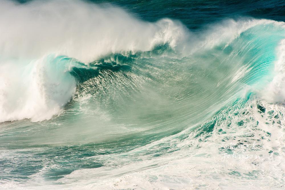 Huge wave breaking off the Na Pali Coast of Kauai, Hawaii during a giant northwest winter ground swell