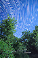 Stars rise over Salt Creek in Weldon Springs State Park. This startrail sequence covers shows the stars movement in 73 minutes. <br /> <br /> Date Taken: August 13, 2014