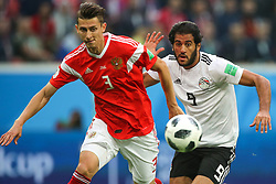 June 19, 2018 - Saint Petersburg, Russia - Ilya Kutepov (L) of the Russia national football team and Marwan Mohsen of the Egypt national football team vie for the ball during the 2018 FIFA World Cup match, first stage - Group A between Russia and Egypt at Saint Petersburg Stadium on June 19, 2018 in St. Petersburg, Russia. (Credit Image: © Igor Russak/NurPhoto via ZUMA Press)