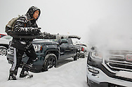 Photo Randy Vanderveen<br /> Grande Prairie, Alberta, Canada<br /> 2017-01-05<br /> Jason Naguit, a lot attendant at Ken Sargent GMC Buick Ltd. stirs up a miniature blizzard as he clears snow off the new pickups at the northside dealership. Using the blower prevents any accidental damage to the paint of the vehicles and also makes the job fast.