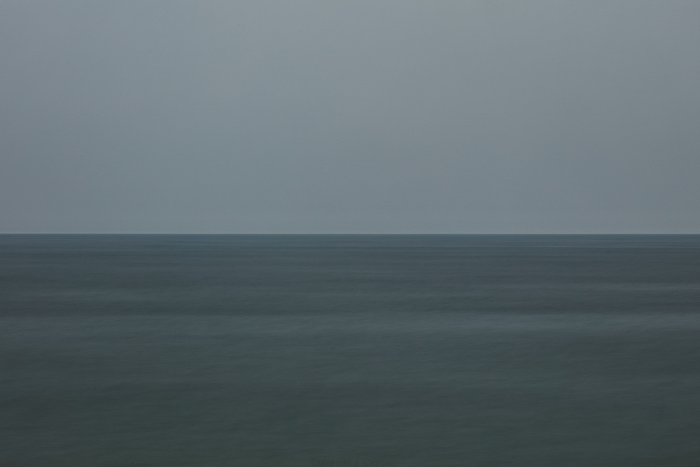 A calm gray day on the Atlantic Ocean looking out from Miacomet.