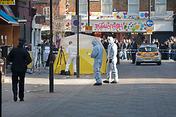© licensed to London News Pictures. London, UK 26/02/2012. A forensic team is investigating a crime scene on Inverness Street after a man was stabbed to death in Camden Town in the early hours of this morning. Photo credit: Tolga Akmen/LNP