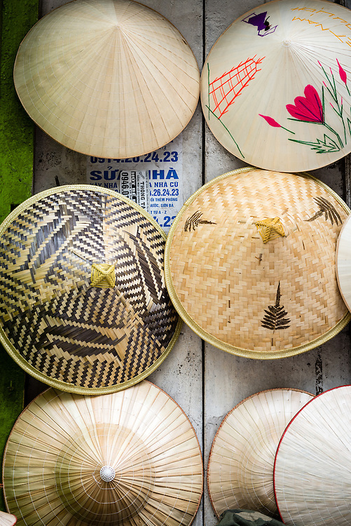Traditional Vietnamese conical hats hanging on a wall