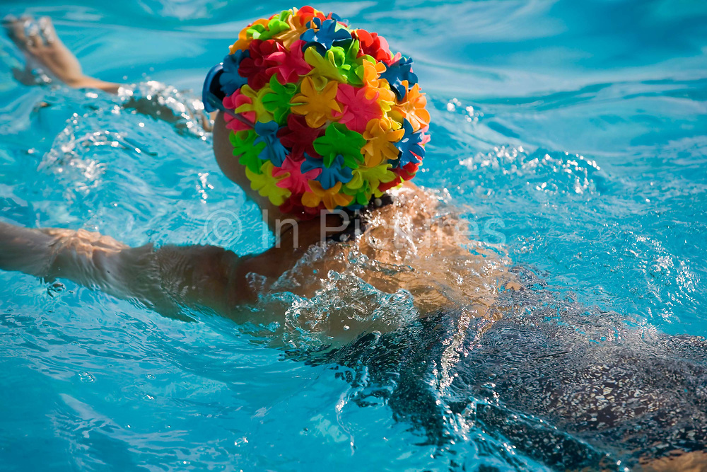 A woman swimming in the pool at Tooting Bec Lido<br /> Tooting Bec Lido is the largest open-air swimming pool in London. Opened in 1906 it is still popular and used throughout the year by swimmers.
