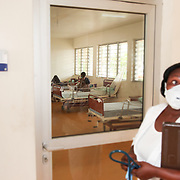INDIVIDUAL(S) PHOTOGRAPHED: N/A. LOCATION: Tuberculosis Hospital, Calabar, Cross River, Nigeria. CAPTION: A staff member prepares to enter the male ward at the tuberculosis hospital.
