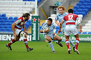 Casey Laulala of Cardiff Blues © looks to go past Sebastien Chabal (l).  Heineken cup, Cardiff Blues v Racing Metro at the Cardiff city stadium in Cardiff, South Wales  on Sunday 22nd  Jan 2012. pic by Andrew Orchard, Andrew Orchard sports photography,