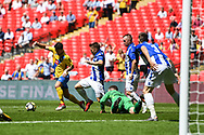 Chris Stockton of Stockton Town (15) collects the ball as Chris Rackley of Thatcham Town (1) fails to collect the loose ball during the FA Vase match between Stockton Town and Thatcham Town at Wembley Stadium, London, England on 20 May 2018. Picture by Stephen Wright