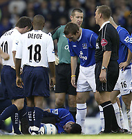 Fotball<br /> Premier League 2004/2005<br /> Foto: SBI/Digitalsport<br /> NORWAY ONLY<br /> <br /> Everton v Tottenham Hotspur<br /> Barclays Premiership.<br /> 03/10/2004.<br /> <br /> Everton's Tim Cahill lays injured on the floor after Jamie Redknapp's horror tackle