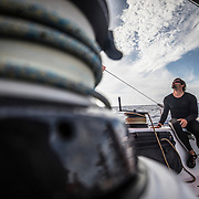 Leg 02, Lisbon to Cape Town, day 12, on board MAPFRE, Guillermo Altadill triming sails. Photo by Ugo Fonolla/Volvo Ocean Race. 16 November, 2017