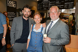 Left to right, DOUGRAY SCOTT, MARTHA WARD and SIMON KELNER at a party to celebrate the launch of Top Dog at 48 Frith Street, Soho, London on 27th May 2015
