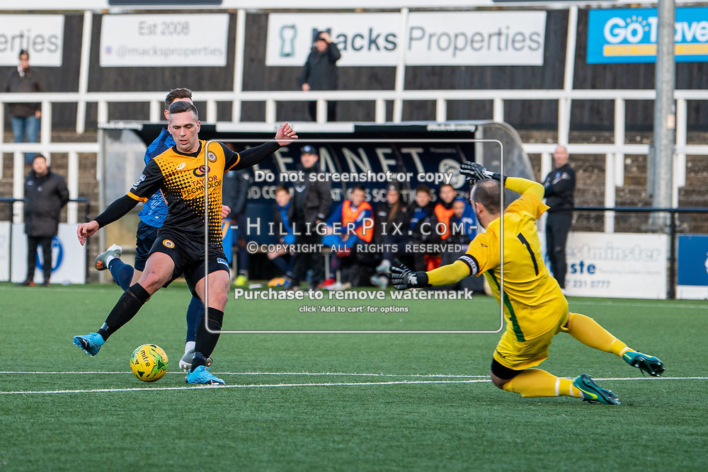 BROMLEY, UK - JANUARY 04: Joseph Taylor, of Cray Wanderers FC, faces the on rushing Shane Gore, of Wingate & Finchley,  when through on goal during the BetVictor Isthmian Premier League match between Cray Wanderers and Wingate & Finchley at Hayes Lane on January 4, 2020 in Bromley, UK. <br /> (Photo: Jon Hilliger)