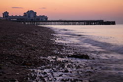 © Licensed to London News Pictures. 14/09/2016. Portsmouth, UK.  Dawn breaks over South Parade Pier in Southsea this morning, 14th September 2016. Temperatures are set to remain warm over the coming days in the south of England. Photo credit: Rob Arnold/LNP