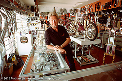 """Arlen Ness in the showroom of his second San Leandro store, custom """"Two Bad"""" in the background. Photograph ©Michael Lichter 1987"""