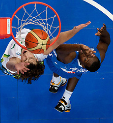 Simas Jasaitis of Lithuania vs Florent Pietrus of France during basketball game between National basketball teams of Lithuania and France at FIBA Europe Eurobasket Lithuania 2011, on September 9, 2011, in Siemens Arena,  Vilnius, Lithuania. France defeated Lithuania 73-67.  (Photo by Vid Ponikvar / Sportida)