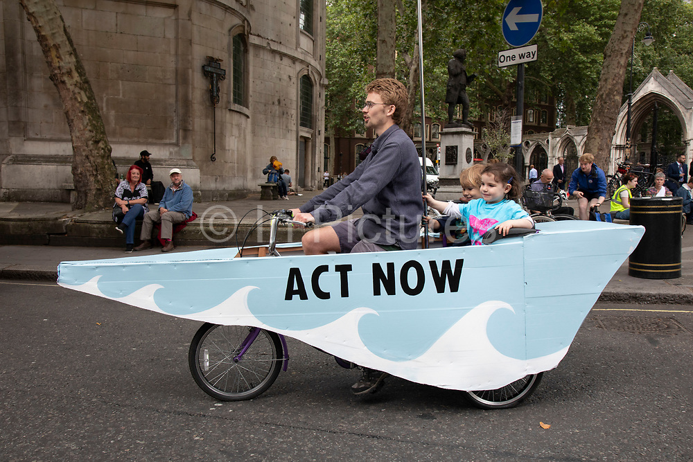 Extinction Rebellion disruption across 5 UK cities calling on Government to ACT NOW outside the Royal Courts of Justice after it was announced last week that more than 1,000 activists who participated in previous demonstrations were facing prosecution, on 15th July 2019 in London, England, United Kingdom. Extinction Rebellion is a climate change group started in 2018 and has gained a huge following of people committed to peaceful protests. These protests are highlighting that the government is not doing enough to avoid catastrophic climate change and to demand the government take radical action to save the planet.
