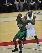 Kevin Garnett, left, and Ben Wallace of Cleveland prepare for a rebound.