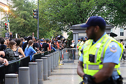 Protestors and police face off at an entrance to a restricted area where law enforcement had a group of people who were spotted with a white supremacist flag and chased by protestors on Sunday, August 12, 2018. Photo by Darryl Smith/TNS/ABACAPRESS.COM