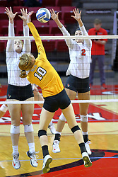 23 November 2017:  Allison Ketcham strikes towards blockers Sydney Holt and Jaelyn Keene during a college women's volleyball match between the Valparaiso Crusaders and the Illinois State Redbirds in the Missouri Valley Conference Tournament at Redbird Arena in Normal IL (Photo by Alan Look)