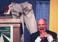 Indiana Lt. Gov. Joe Kernan breaks up in laughter at the Kernan charity roast Tuesday night as Denise Sanford, who was his mayoral secretary, holds the trousers the bomb squad blew up after they arrived in what appeared to be a suspicious package. They were Kernan's trousers. Kernan was the target of satire at a roast attended by 530 people at a $100-a-plate dinner at Notre Dame's Joyce Center. Proceeds go to Life Treatment Centers, facilities for addiction treatment.