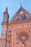 Detail image of the mosaic and sculpture covered facade of the Duomo in Orvieto, Umbria, Italy.