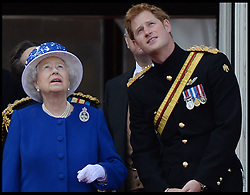 HM The Queen with Prince Harry watch the fly past on the Balcony of Buckingham Palace during Trooping The Colour, London, United Kingdom,<br />