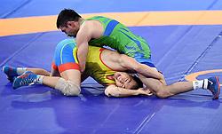 JAKARTA, Aug. 19, 2018  Bekzod Abdurakhmonov (top) of Uzbekistan competes during Men's Wrestling Freestyle 74 kg Final against Daniyar Kaisanov of Kazakhstan at the 18th Asian Games at Jakarta, Indonesia, Aug. 19, 2018. (Credit Image: © Yue Yuewei/Xinhua via ZUMA Wire)
