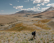 """Paul Salopek trekking. From Aqbelis pass to Baiqara, a Wakhi high pasture. Guiding and photographing Paul Salopek while trekking with 2 donkeys across the """"Roof of the World"""", through the Afghan Pamir and Hindukush mountains, into Pakistan and the Karakoram mountains of the Greater Western Himalaya."""