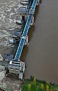 Nederland, Limburg, gemeente Maastricht, 15-11-2010. Stuw Borgharen bij hoogwater, de stuw is gestreken om snelle afvoer van het water mogelijk te maken. .Borgharen weir at high tide, the weir is lowered to allow the water to flow freely and as quickly as possible..luchtfoto (toeslag), aerial photo (additional fee required).foto/photo Siebe Swart