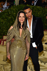 Juliette Binoche and Olivier Rousteing attending the Costume Institute Benefit at The Metropolitan Museum of Art celebrating the opening of Heavenly Bodies: Fashion and the Catholic Imagination. The Metropolitan Museum of Art, New York City, New York, May 7, 2018. Photo by Lionel Hahn/ABACAPRESS.COM