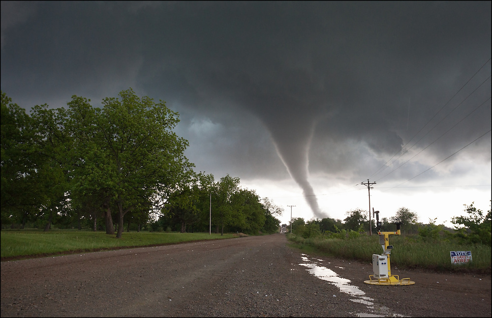 Pod M sitting on a gravel road in Oklahoma with a tornado passing to its south just out of reach of collecting data.